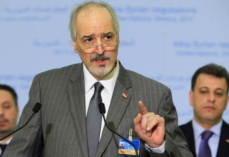 Syrian Ambassador to the UN al Ja'afari addresses the media after a meeting of Intra-Syria peace talks in Geneva