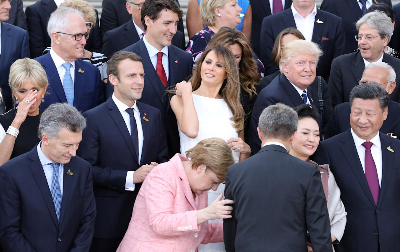 <p>(2nd row L-R) Wife of French President Brigitte Trogneux, French President Emmanuel Macron, First Lady Melania Trump, President Donald Trump as German Chancellor Angela Merkel is seen in front during a family photo prior to a concert at the Elbphilharmonie concert hall during the G20 Summit in Hamburg, Germany, on July 7, 2017. (Photo: Ludovic Marin,Pool/Reuters) </p>