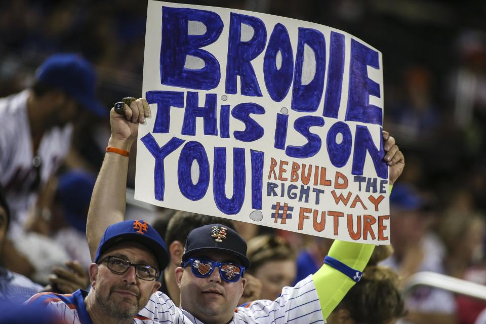 Jun 30, 2019; New York City, NY, USA; A fan holds up a sign directed at New York Mets general manager Brodie Van Wagenen in the seventh inning against the Atlanta Braves at Citi Field. Mandatory Credit: Wendell Cruz-USA TODAY Sports