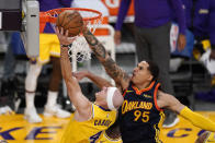 Los Angeles Lakers guard Alex Caruso, left, shoots as Golden State Warriors forward Juan Toscano-Anderson defends during the first half of an NBA basketball Western Conference Play-In game Wednesday, May 19, 2021, in Los Angeles. (AP Photo/Mark J. Terrill)