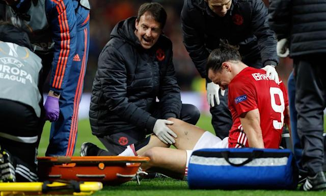 "<span class=""element-image__caption"">Zlatan Ibrahimovic receives treatment after falling awkwardly during Manchester United's Europa League match against Anderlecht on Thursday.</span> <span class=""element-image__credit"">Photograph: Martin Rickett/PA</span>"