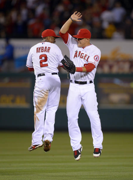 Los Angeles Angels shortstop Erick Aybar, left, and center fielder Mike Trout celebrate after they defeated the Los Angeles Dodgers 4-3 in their baseball game, Wednesday, May 29, 2013, in Anaheim, Calif. (AP Photo/Mark J. Terrill)