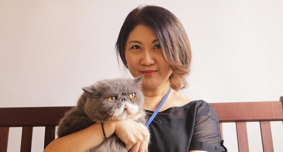 Owner Jessica Seet with her first cat, Brad Pitt. (Photo: Gabriel Choo / Yahoo Lifestyle Singapore)