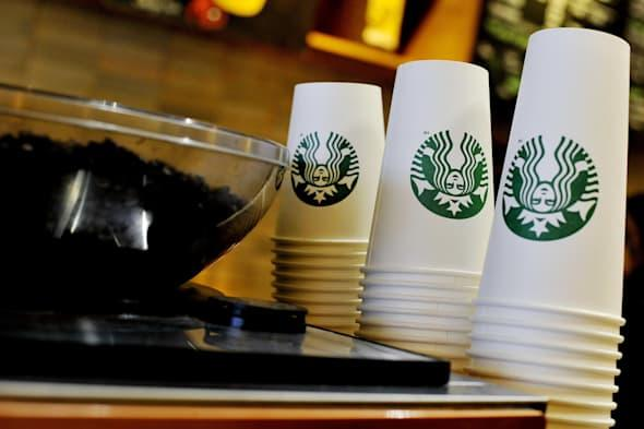 File photo dated 13/08/2013 of Starbucks takeaway cups at a  Starbucks in central London, as the coffee shop chain announced it is moving its European headquarters from the Netherlands to the UK following a row over tax avoidance. PRESS ASSOCIATION Photo. Issue date: Wednesday April 16, 2014. Starbucks announced it would