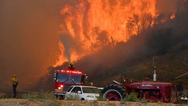 PHOTO: Firefighters arrive to battle the Tick fire, a wind driven wild fire in the hills of Canyon Country north of Los Angeles, Oct. 24, 2019. (Gene Blevins/Reuters)