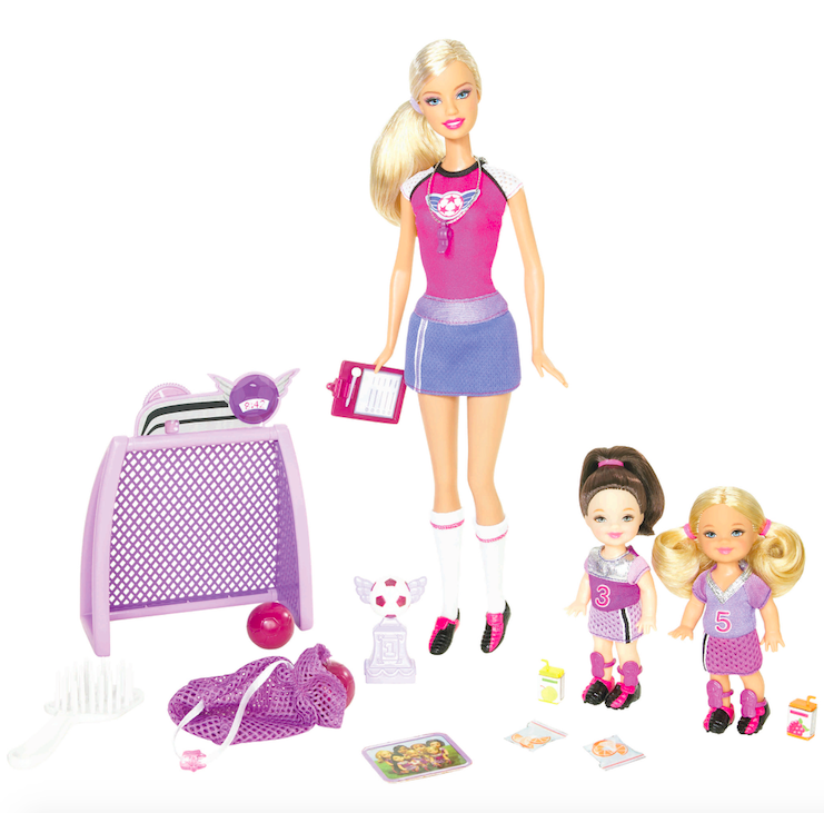 <p>Soccer Coach Barbie looks sporty and stylish as she takes to the field with her adorable team. </p>