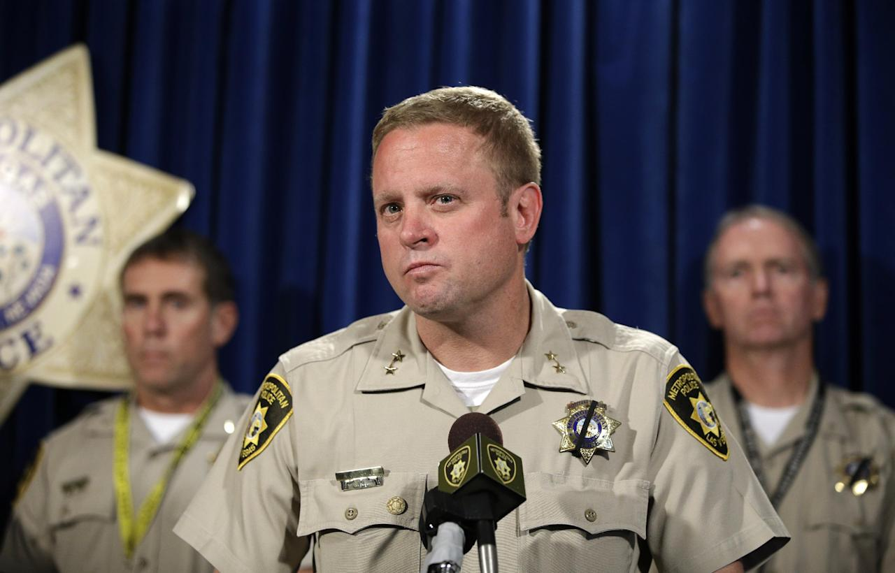 Las Vegas Assistant Sheriff Kevin McMahill, center, speaks during a news conference, Monday, June 9, 2014, in Las Vegas. Police say two police officers, along with a bystander, were killed by Jerad and Amanda Miller yesterday. (AP Photo/John Locher)