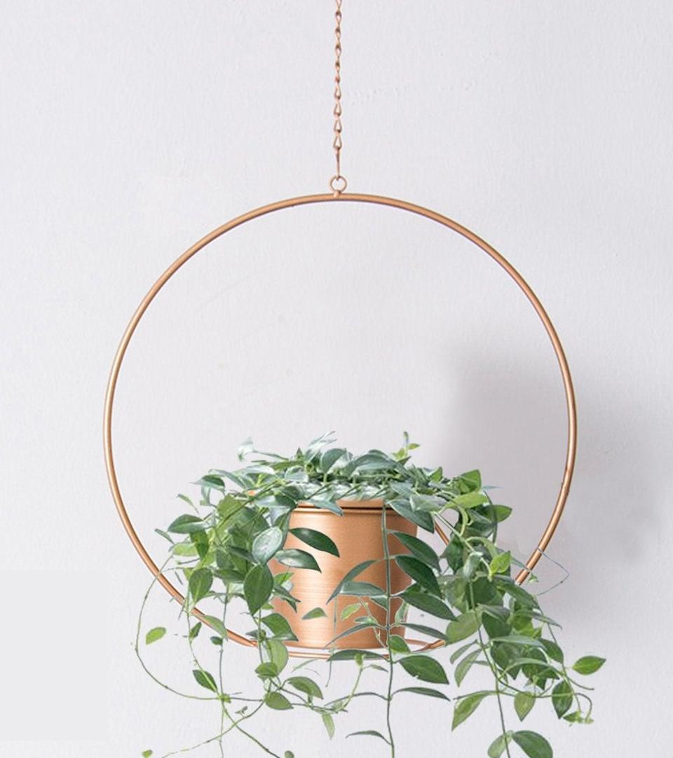 "<h3><a href=""https://amzn.to/2DScEve"" rel=""nofollow noopener"" target=""_blank"" data-ylk=""slk:Gold Metal Hanging Planter"" class=""link rapid-noclick-resp"">Gold Metal Hanging Planter</a> </h3><br>Their most-cherished succulent can dangle delicately from the ceiling inside this statement planter. <br><br><strong>RISEON</strong> Boho Gold Metal Plant Hanger, $, available at <a href=""https://amzn.to/2DScEve"" rel=""nofollow noopener"" target=""_blank"" data-ylk=""slk:Amazon"" class=""link rapid-noclick-resp"">Amazon</a>"