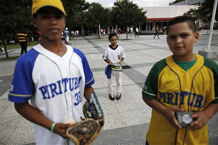 Children from Pirituba club, a Brazilian baseball club, are pictured during a summer baseball festival for children at the Sesc Belenzinho club in Sao Paulo January 19, 2014. REUTERS/Nacho Doce