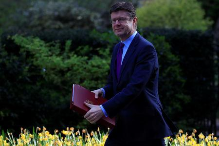 FILE PHOTO: Britain's Secretary of State for Business Greg Clark  walks at Downing Street in London, Britain April 10, 2019. REUTERS/Gonzalo Fuentes/File Photo