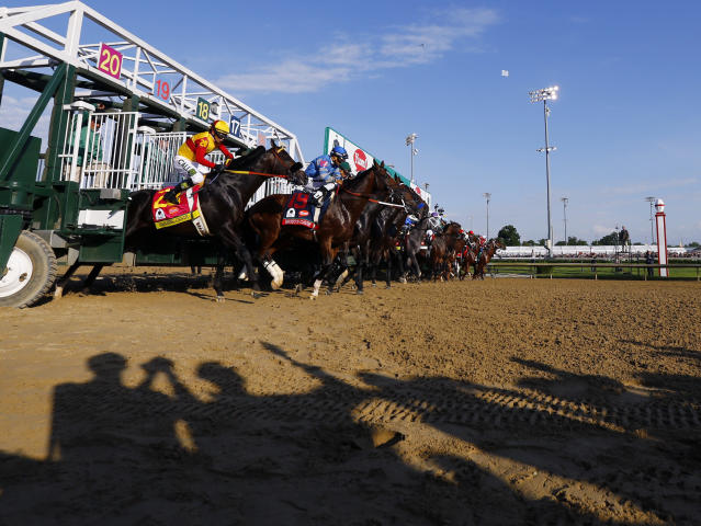FILE - In this May 7, 2016, file photo, the field breaks from the starting gate during the 142nd running of the Kentucky Derby horse race at Churchill Downs in Louisville, Ky. Horses running in the Kentucky Derby will break from a new custom-made 20-stall starting gate for the 146th edition in May. Churchill Downs said Monday, Feb. 3, 2020, the new contiguous gate will eliminate the wide gap between post position No. 14 in the standard gate and No. 15 in the auxiliary gate. (AP Photo/Julio Cortez, File)