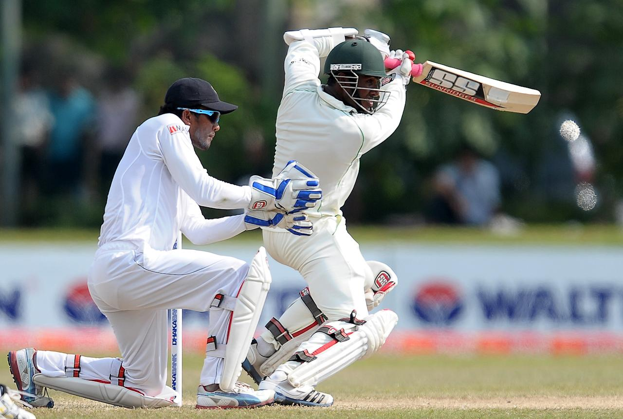 Bangladeshi cricketer Jahurul Islam (R) is watched by Sri Lankan wicketkeeper Dinesh Chandimal as he plays a shot during the final day of the opening Test match between Sri Lanka and Bangladesh at the Galle International Cricket Stadium in Galle on March 12, 2013.  The opening Test between Sri Lanka and Bangladesh ended in a tame draw on the fifth and final day at the Galle International Stadium on Tuesday. AFP PHOTO/ LAKRUWAN WANNIARACHCHI        (Photo credit should read LAKRUWAN WANNIARACHCHI/AFP/Getty Images)