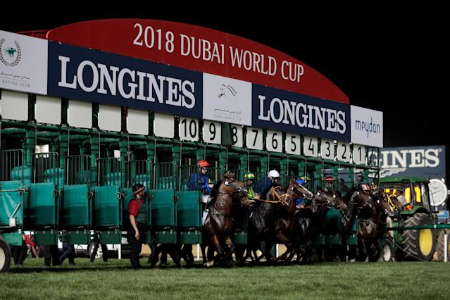 Horse Racing - Dubai World Cup 2018 - Meydan Racecourse, Dubai - United Arab Emirates - March 31, 2018 - Jockeys compete during the Eighth Race. REUTERS/Christopher Pike