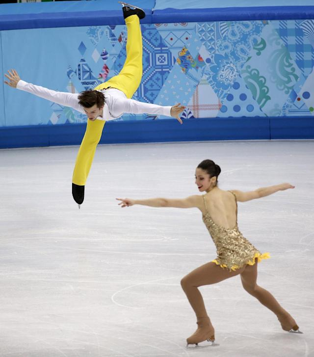 Stefania Berton and Ondrej Hotarek of Italy compete in the pairs short program figure skating competition at the Iceberg Skating Palace during the 2014 Winter Olympics, Tuesday, Feb. 11, 2014, in Sochi, Russia. (AP Photo/Bernat Armangue)
