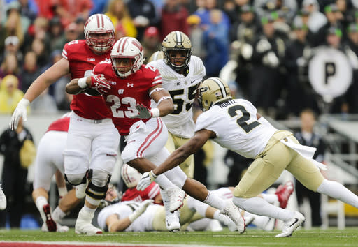 Wisconsin running back Jonathan Taylor gets past Purdue cornerback Da'Wan Hunte (2) on a 67-yard touchdown run during the first half of an NCAA college football game, Saturday, Oct. 14, 2017, in Madison, Wis. (AP Photo/Andy Manis)