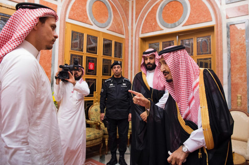 "In this photo released by Saudi Press Agency, SPA, Saudi King Salman, right, points to Salah, a son, of Jamal Khashoggi as Crown Prince Mohammed bin Salman, second right, looks on, in Riyadh, Saudi Arabia, Tuesday, Oct. 23, 2018. Saudi Arabia, which for weeks maintained that Jamal Khashoggi had left the Istanbul consulate, on Saturday acknowledged he was killed there in a ""fistfight."" (Saudi Press Agency via AP)"