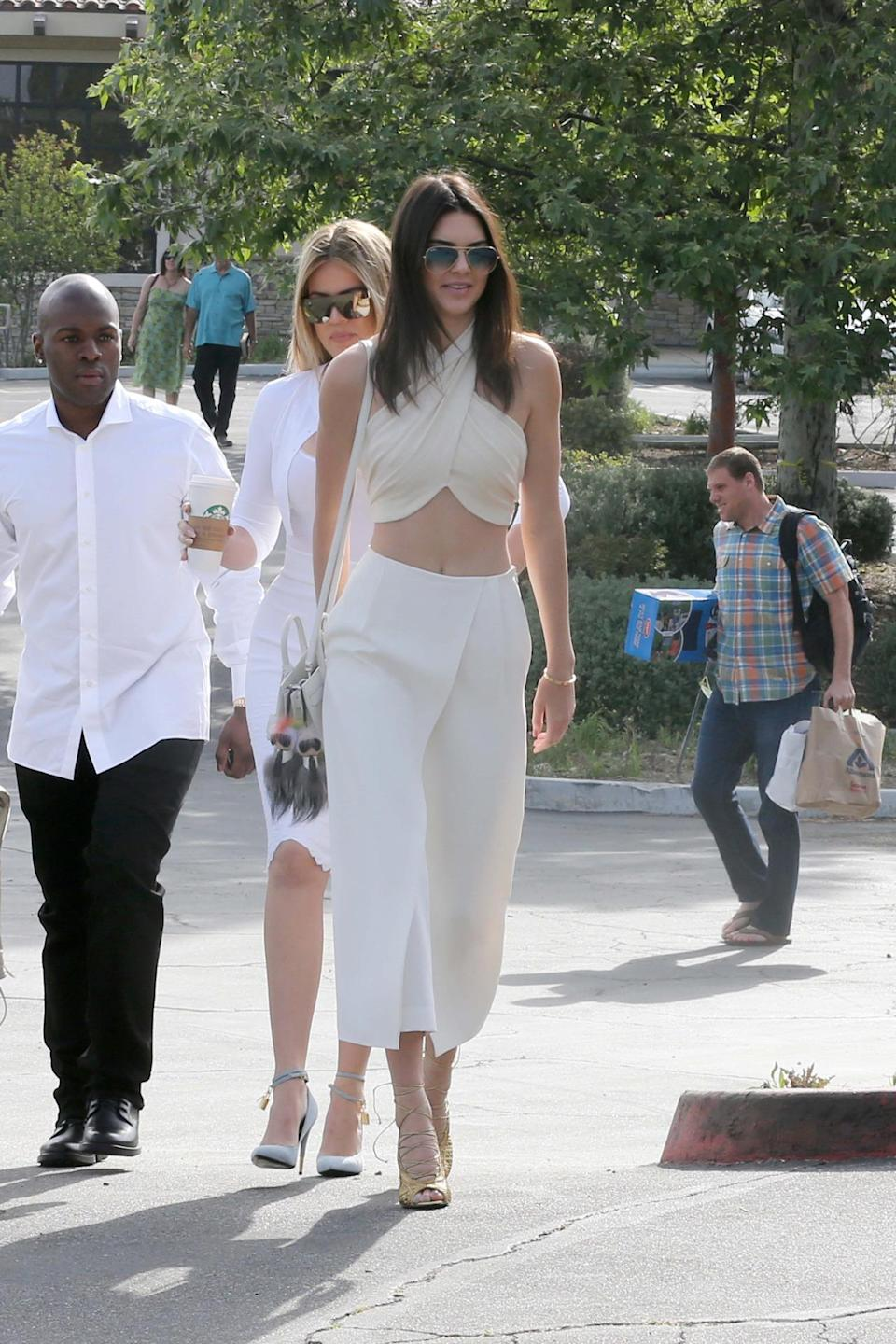 <p>Jenner took church service style to a whole new level when she attended Easter mass in a cream-colored halter-top and high-waist skants (skirt-pants, that is) with her family. </p>