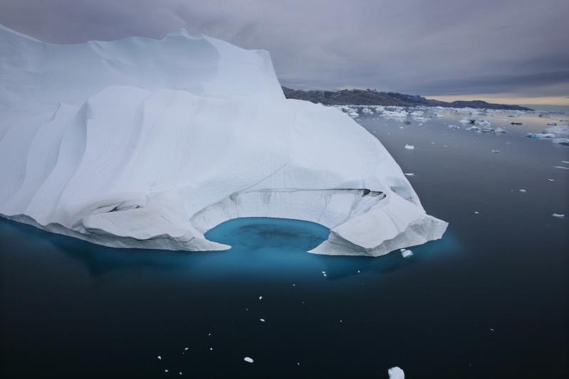 FILE - In this July 19, 2007 file photo, an iceberg melts off the coast of Ammasalik, Greenland. Scientists who are fine-tuning a landmark U.N. report on climate change are struggling to explain why global warming appears to have slowed down in the past 15 years even as greenhouse gas emissions keep rising. Leaked documents show there is widespread disagreement among governments over how to address the contentious issue in the Sept. 23-26 stock-taking report by the Intergovernmental Panel on Climate Change. (AP Photo/John McConnico, File)