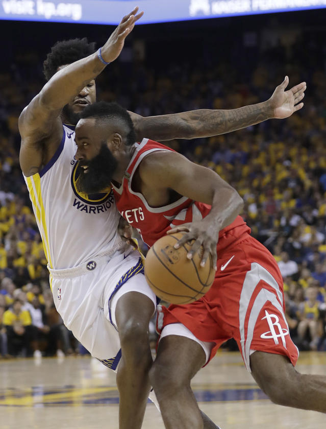 Houston Rockets guard James Harden, right, drives against Golden State Warriors forward Jordan Bell during the first half of Game 6 of the NBA basketball Western Conference Finals in Oakland, Calif., Saturday, May 26, 2018. (AP Photo/Marcio Jose Sanchez)
