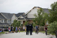 <p>Police examine a neighbourhood after a tornado touched down, in Barrie, Ont., on Thursday, July 15, 2021. THE CANADIAN PRESS/Christopher Katsarov</p>