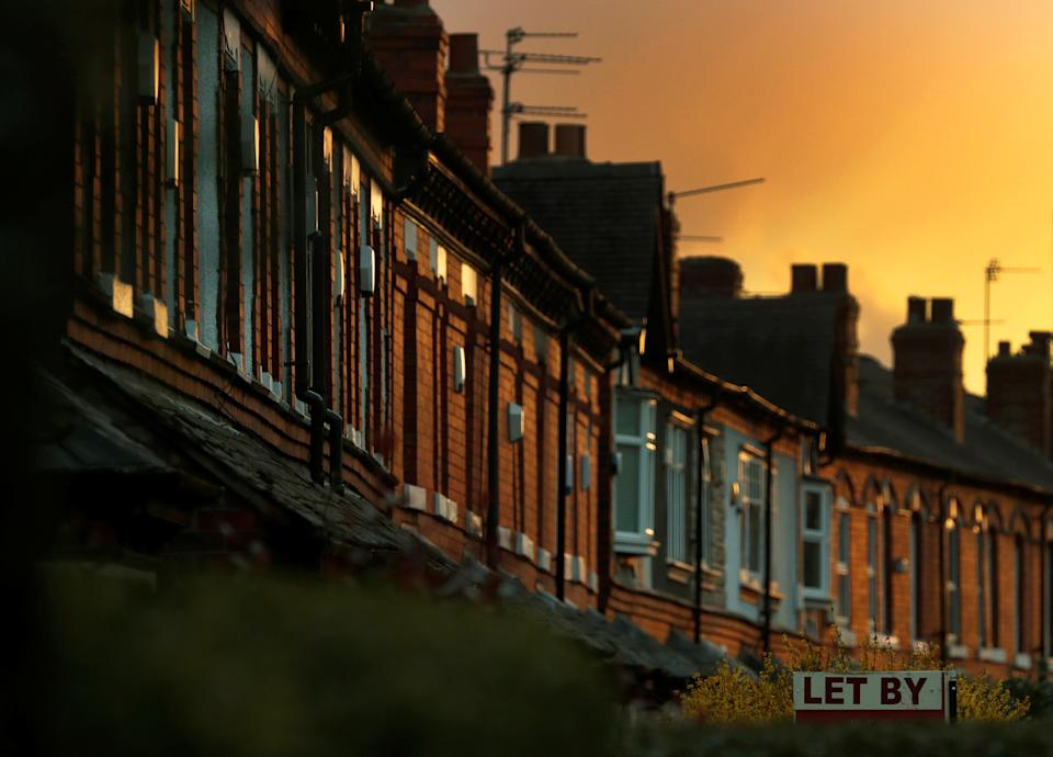 An estate agents sign for a house to rent is seen in front of a row of terraced houses in Altrincham northern England, April 16, 2016. REUTERS/Phil Noble