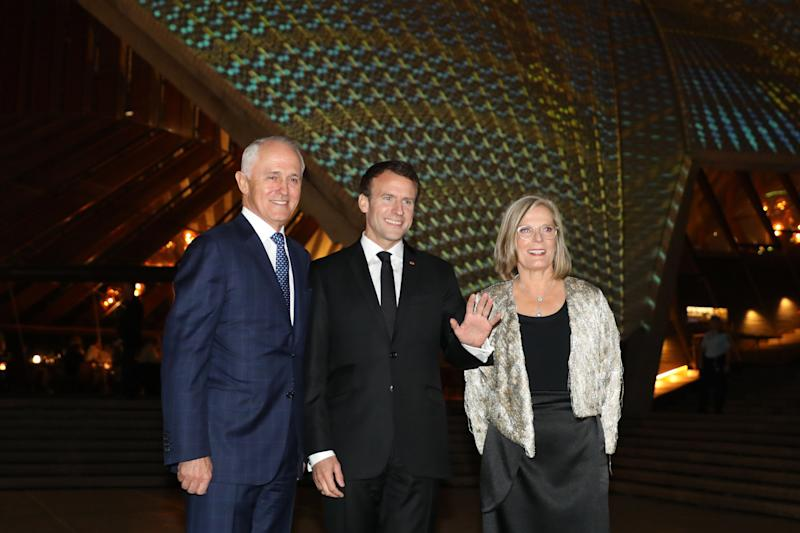 France's President Emmanuel Macron (C) poses for a photo with Australia's Prime Minister Malcolm Turnbull (L) and his wife Lucy Turnbull (R) outside the Sydney Opera House in Sydney on May 1, 2018. - Macron arrived in Australia on May 1 on a rare visit by a French president with the two sides expected to agree on greater cooperation in the Pacific to counter a rising China. (Photo by ludovic MARIN / POOL / AFP) (Photo credit should read LUDOVIC MARIN/AFP/Getty Images)