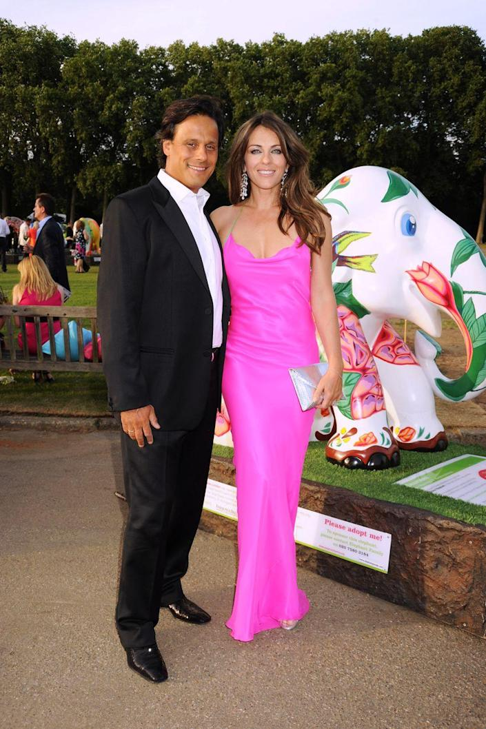 """<p>Elizabeth and her husband of eight years, Arun Nayar, separated in late 2010. By June 2011, their divorce was final, with Elizabeth citing his """"unreasonable behavior"""" as the cause.</p>"""