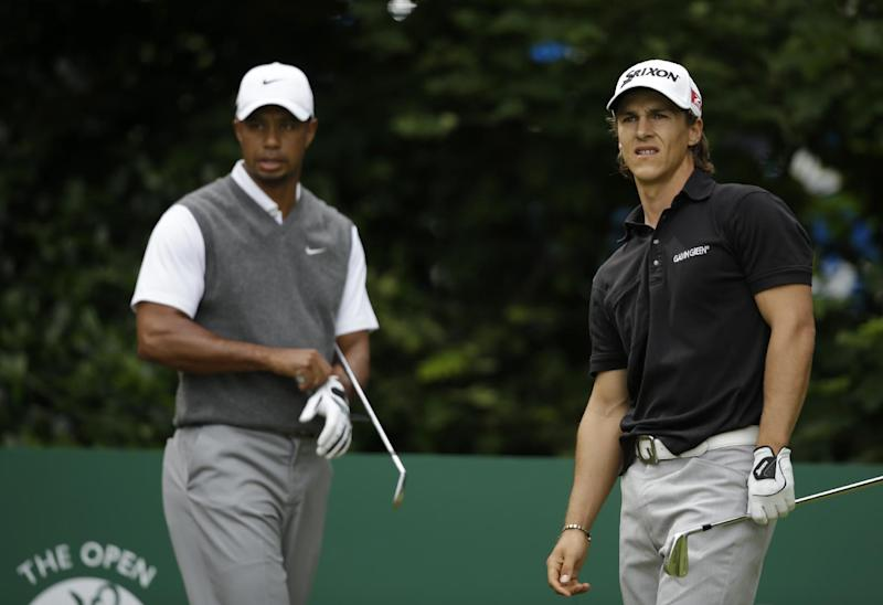 Thorbjorn Olesen of Denmark, right, watches his shot off the first tee as Tiger Woods of the United States looks on at Royal Lytham & St Annes golf club during the third round of the British Open Golf Championship, Lytham St Annes, England, Saturday, July 21, 2012. (AP Photo/Tim Hales)