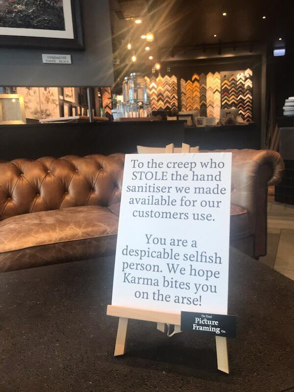 This was the sign erected inside the cafe after the woman's brazen act. Source: Supplied