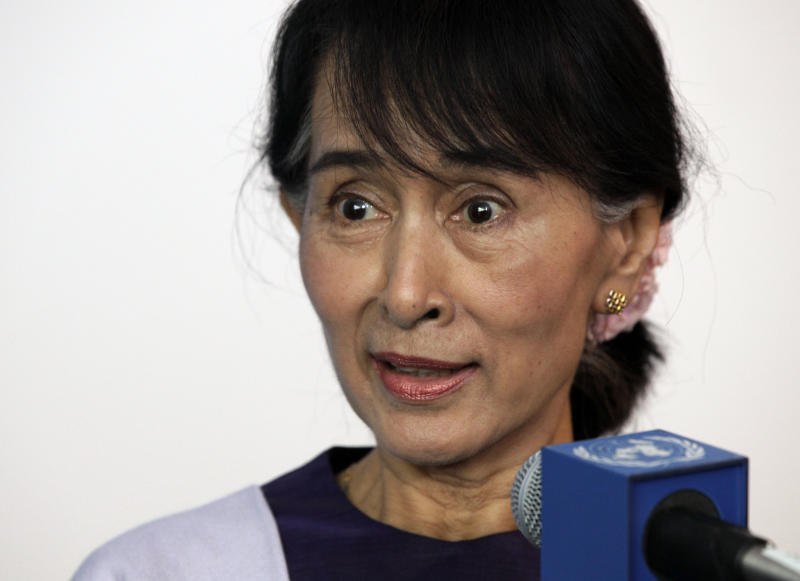 Myanmar democracy leader Aung San Suu Kyi responds to a question during a brief news conference at the United Nations, Friday, Sept. 21, 2012. (AP Photo/Richard Drew)