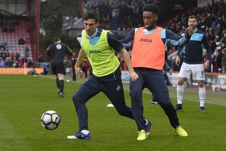 Swansea City's Leroy Fer and Jack Cork warm up before the game