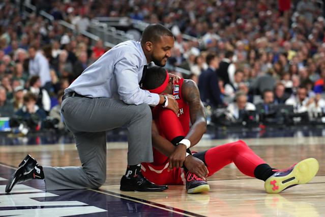 Tariq Owens #11 of the Texas Tech Red Raiders reacts on the court after suffering an injury in the second half against the Michigan State Spartans during the 2019 NCAA Final Four semifinal at U.S. Bank Stadium on April 6, 2019 in Minneapolis, Minnesota. (Photo by Tom Pennington/Getty Images)