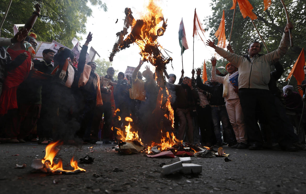 Indians burn an effigy representing rapists as they protest against the recent gang-rape of a young woman in a moving bus in New Delhi, India, Wednesday, Dec. 26, 2012. On Tuesday, authorities have sealed off a high-security zone in the Indian capital for a second day to put an end to a week of demonstrations against the brutal gang-rape. (AP Photo/ Saurabh Das)