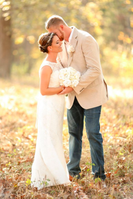 Caleb and Casey had a very unwanted guest crash their wedding photos. Photo: Ashley Wills Photography