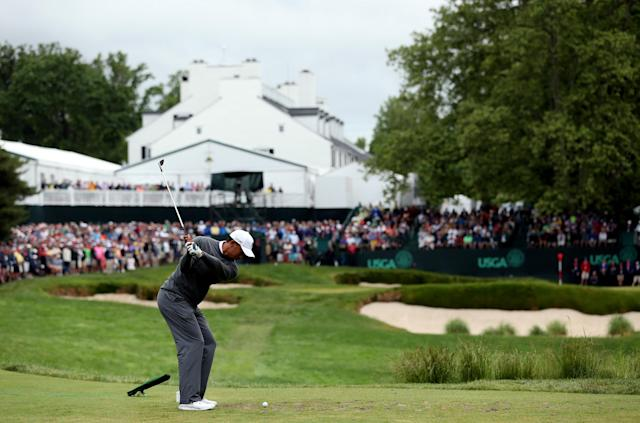 ARDMORE, PA - JUNE 14: Tiger Woods of the United States hits his tee shot on the 13th hole during a continuation of Round One of the 113th U.S. Open at Merion Golf Club on June 14, 2013 in Ardmore, Pennsylvania. (Photo by Andrew Redington/Getty Images)