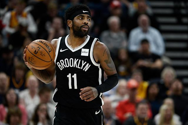 After missing 26 games with a lingering shoulder injury, Nets guard Kyrie Irving should be back on the court Sunday against Atlanta. (Alex Goodlett/Getty Images)
