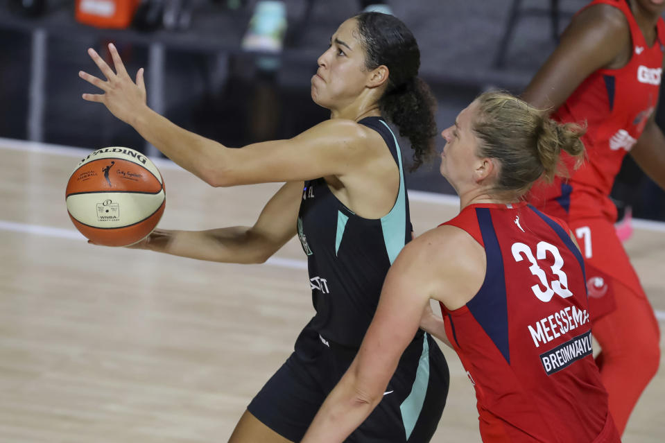 FILE - New York Liberty's Kia Nurse, left, drives past Washington Mystics' Emma Meesseman during the first half of a WNBA basketball game in Bradenton, Fla., in this Saturday, Sept. 12, 2020, file photo. The New York Liberty acquired Natasha Howard from the Seattle Storm as part of a tree-team trade Wednesday, Feb. 10, 2021. The three-time WNBA champion goes to the Liberty for the No. 1 pick in the draft this year and the Phoenix Mercury's first-round pick next year. The Liberty acquired that pick from Phoenix by sending Kia Nurse and Megan Walker to the Mercury for the sixth pick this year and the first round pick next year. (AP Photo/Mike Carlson, File)