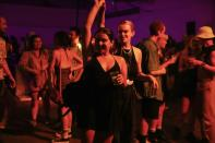"""Revellers dance during the """"00:01"""" event organised by Egyptian Elbows at Oval Space nightclub, as England lifted most coronavirus disease (COVID-19) restrictions at midnight, in London"""