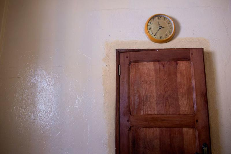 A clock that had stopped hangs above the door in a conference room, at the sex crimes prosecution unit on Dec. 13, 2017.