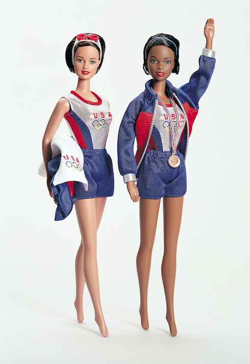 "<p>Olympic Swimmer Barbie takes to the podium with a sleek bob, warm-up jacket and, of course, the gold. </p><p><a href=""http://www.goodhousekeeping.com/beauty/fashion/g4417/swimsuits-every-decade/"" rel=""nofollow noopener"" target=""_blank"" data-ylk=""slk:The best retro swimsuits by decade »"" class=""link rapid-noclick-resp""><em>The best retro swimsuits by decade »</em></a></p>"