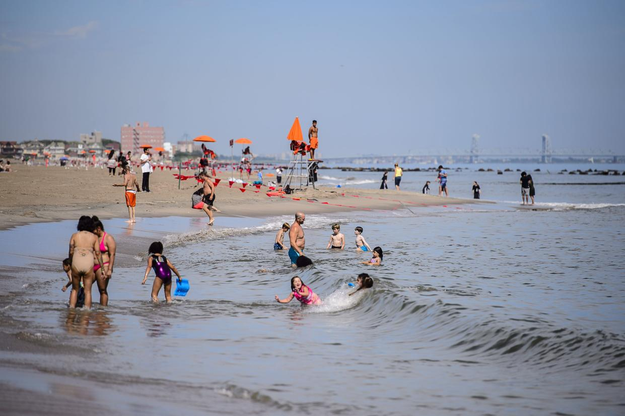 Under the watchful eye of lifeguards, some beachgoers ventured into the surf at Coney Island on the first day swimming allowed at New York City beaches on July 1, 2020.