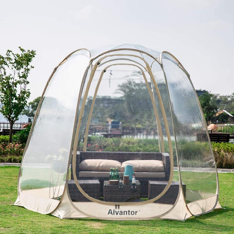 """Have a covered lounge area *and* protect outdoor furniture from impromptu rain showers with this cool pod. There's enough room inside for a loveseat, two cushions and a small table.<br /><br /><strong>Promising review:</strong>""""It keeps cold wind and leaves out and some heat in. There are zip vents at top to let in fresh air and two zipper doors.<strong>This has extended the season for hot tub use, we were able to set up in early March in Chicago area.</strong>Would also be fun for around a small picnic table and to sit outside in the rain."""" —<a href=""""https://amzn.to/3ayqh3A"""" target=""""_blank"""" rel=""""nofollow noopener noreferrer"""" data-skimlinks-tracking=""""5580838"""" data-vars-affiliate=""""Amazon"""" data-vars-href=""""https://www.amazon.com/gp/customer-reviews/RFVC8SEI6HO0N?tag=bfgenevieve-20&ascsubtag=5580838%2C28%2C33%2Cmobile_web%2C0%2C0%2C1159966"""" data-vars-keywords=""""cleaning,fast fashion"""" data-vars-link-id=""""1159966"""" data-vars-price="""""""" data-vars-product-id=""""16176943"""" data-vars-retailers=""""Amazon"""">Amazon Customer</a><br /><br /><strong>Get it from Amazon for<a href=""""https://amzn.to/3tMchL7"""" target=""""_blank"""" rel=""""nofollow noopener noreferrer"""" data-skimlinks-tracking=""""5580838"""" data-vars-affiliate=""""Amazon"""" data-vars-asin=""""B07YZ2KTTJ"""" data-vars-href=""""https://www.amazon.com/dp/B07YZ2KTTJ?tag=bfgenevieve-20&ascsubtag=5580838%2C28%2C33%2Cmobile_web%2C0%2C0%2C1159947"""" data-vars-keywords=""""cleaning,fast fashion"""" data-vars-link-id=""""1159947"""" data-vars-price="""""""" data-vars-product-id=""""16176942"""" data-vars-product-img=""""https://m.media-amazon.com/images/I/515fdq2wq3L._SL500_.jpg"""" data-vars-product-title=""""Alvantor Bubble Tent Screen House Room Camping Tent Canopy Gazebos 4-6 Person for Patios, Large Oversize Weather Pod, Premium Greenhouse Instant Pop Up Tent, Cold Protection Beige 10'×10'"""" data-vars-retailers=""""Amazon"""">$349.99+</a>(available in four sizes).</strong>"""