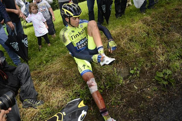 Spanish rider Alberto Contador sits on a verge after his fall on July 14, 2015 during the tenth stage of the Tour de France, between Mulhouse and La Planche des Belles Filles (AFP Photo/Lionel Bonaventure)