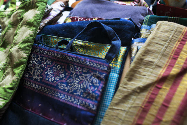 Colorful textiles are sold at The Exchange House in Akron, Ohio. (Maddie McGarvey for HuffPost)