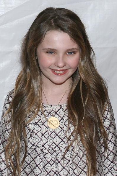 <p>11 year old Abigail Breslin must have spent most of her life growing her long hair.</p>