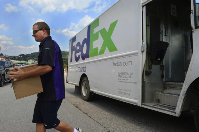 FedEx earnings will be in focus for markets on Tuesday.  (Kenny Kemp/Charleston Gazette-Mail via AP)
