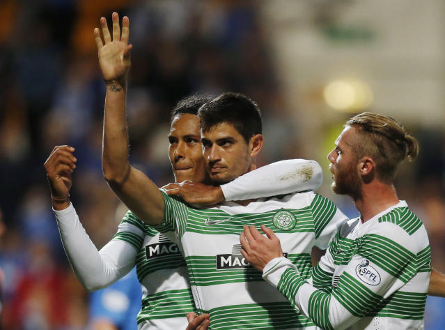 Celtic's Nir Bitton, centre, celebrates his goal with teammates Virgil Van Dijk, background and Celtic's Jo Inge Berget, during their Scottish Premier League soccer match against St Johnstone, at McDiarmid Park, in Perth, Scotland, Wednesday Aug. 13, 2014. (AP Photo/PA, Danny Lawson)