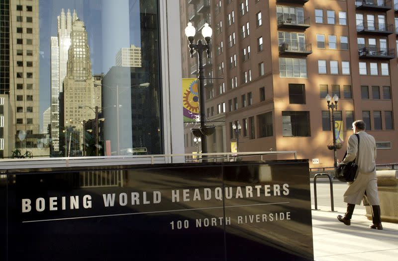 FILE PHOTO: Pedestrian walks past Boeing World Headquarters office building in Chicago