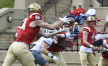 VMI quarterback Seth Morgan (4) hits receiver Jakob Herres for a first down during the first half of an NCAA college football game against The Citadel, Saturday, April 17, 2021, in Lexington, Va. (David Hungate/Roanoke Times via AP)