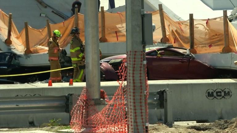 <p>Rescue workers arrive on site shortly after a newly-installed pedestrian bridge collapsed over a highway in Miami on a college campus. Photo from AFPTV. </p>